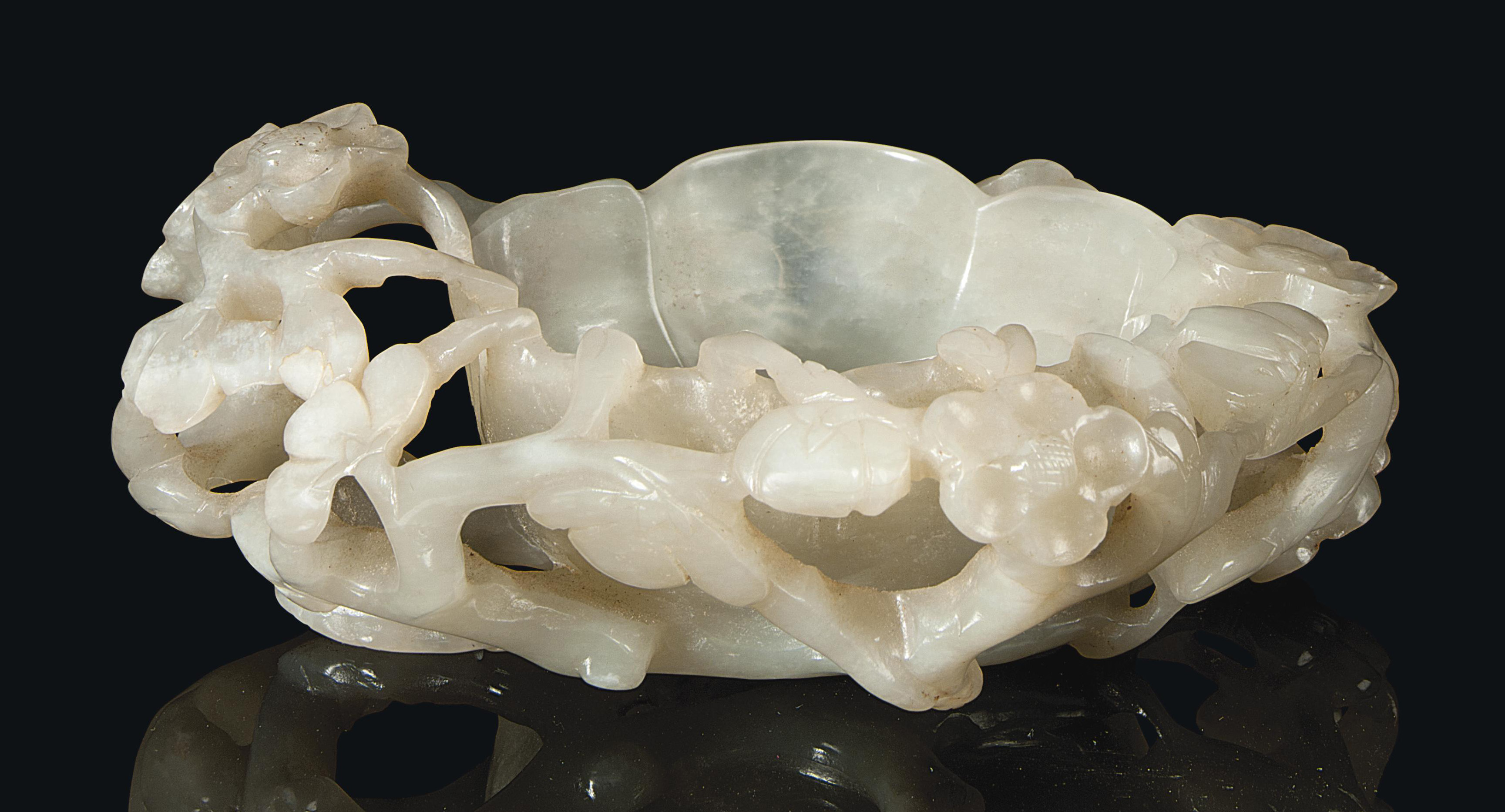 A CHINESE PALE CELADON JADE FO