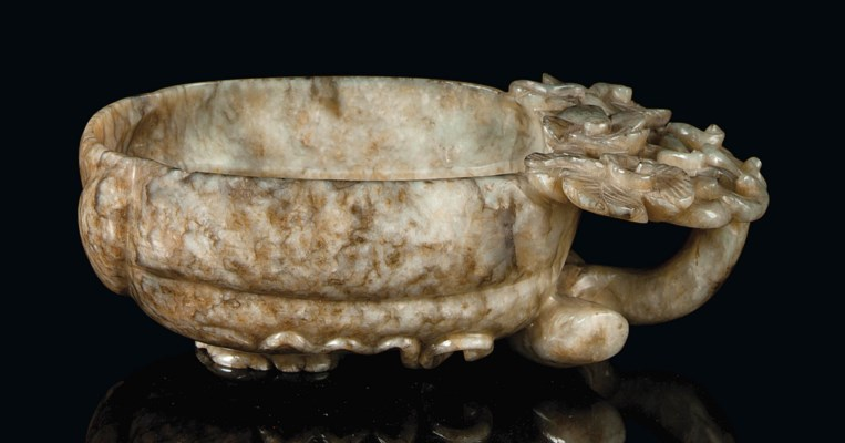 A CHINESE MOTTLED JADE CUP