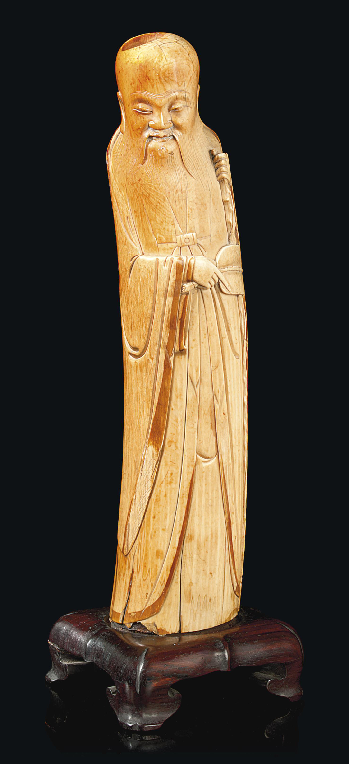 A CHINESE IVORY CARVING OF AN