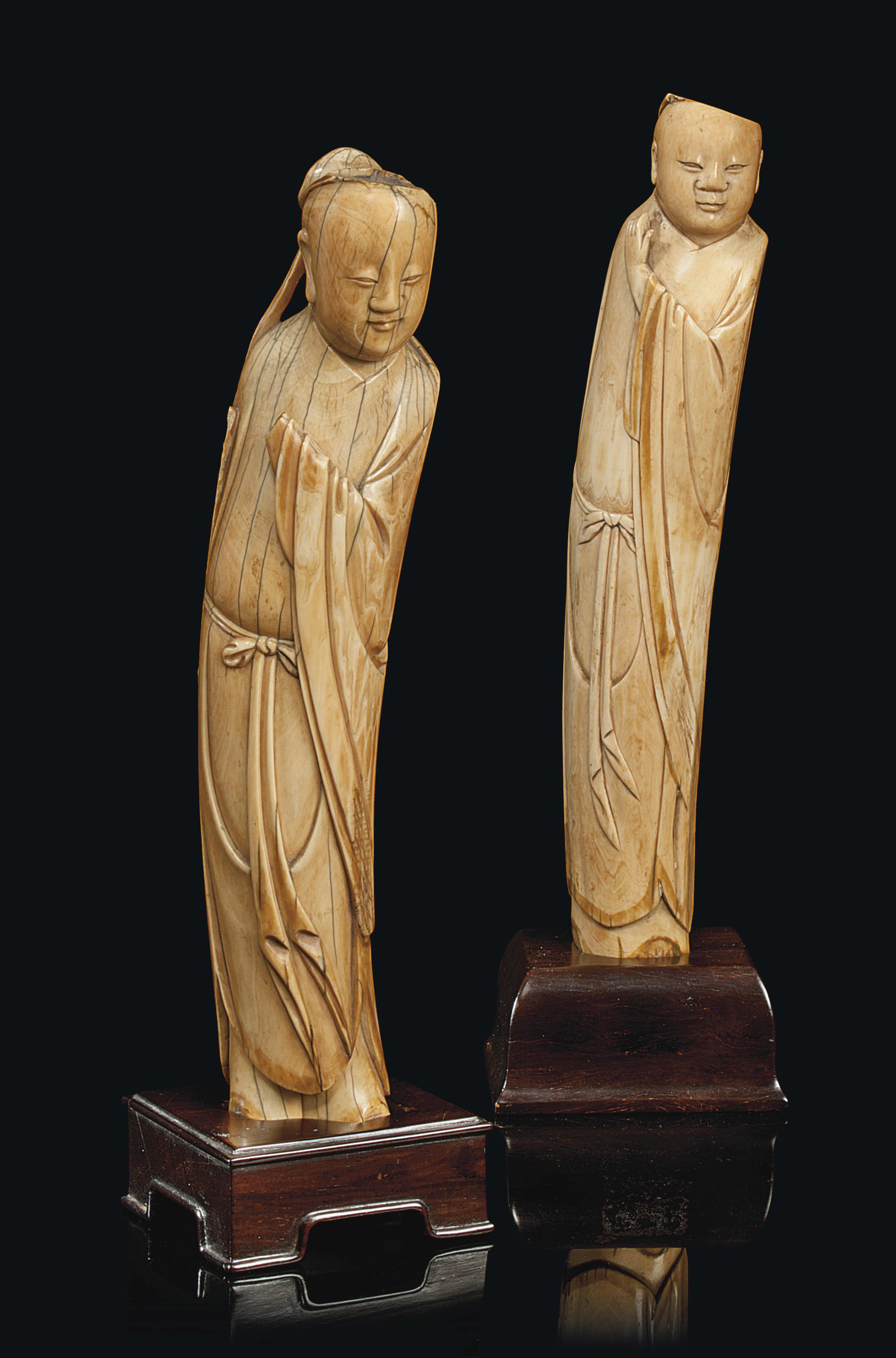 TWO CHINESE IVORY SLENDER FIGU