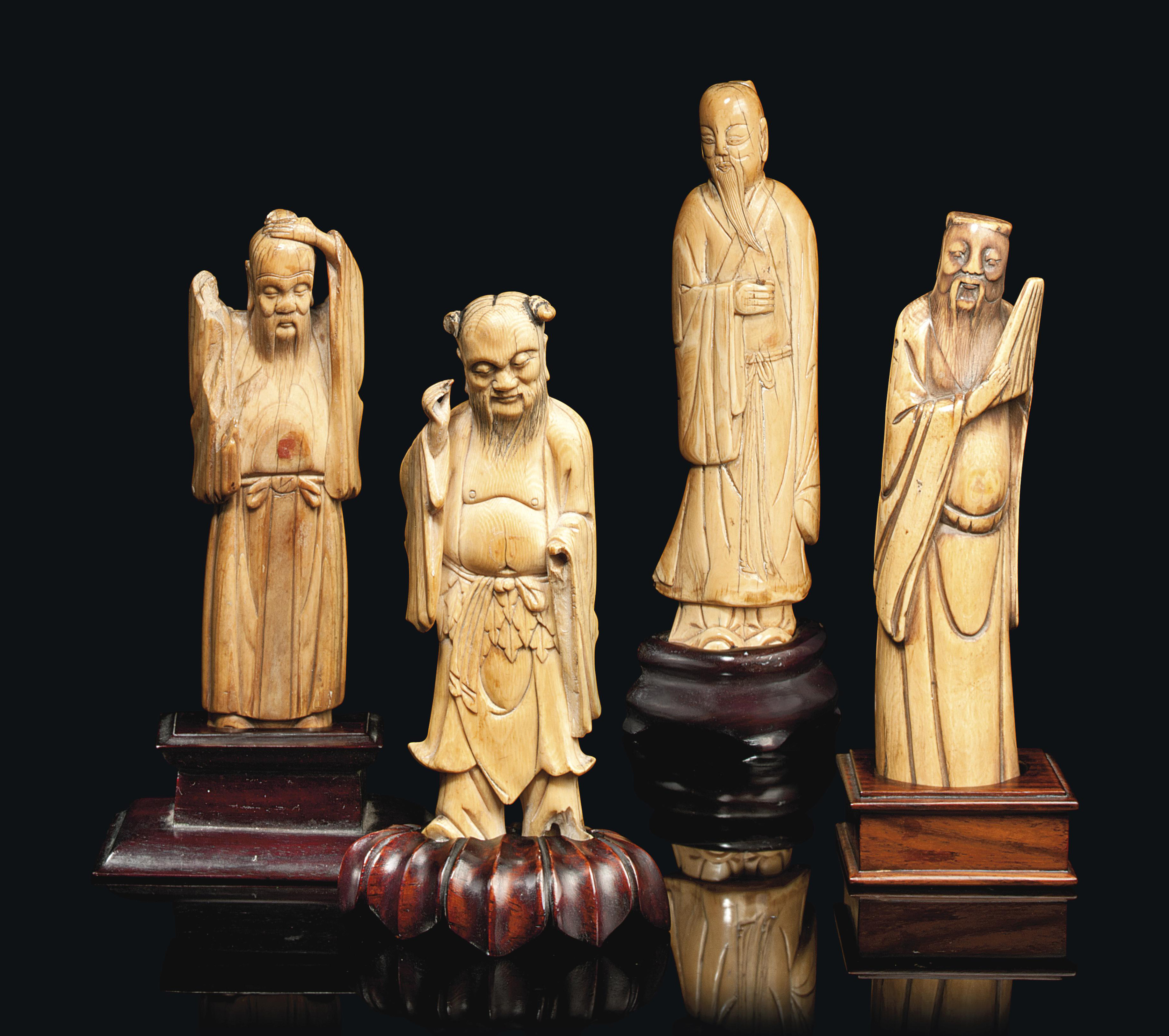FOUR CHINESE IVORY CARVINGS OF
