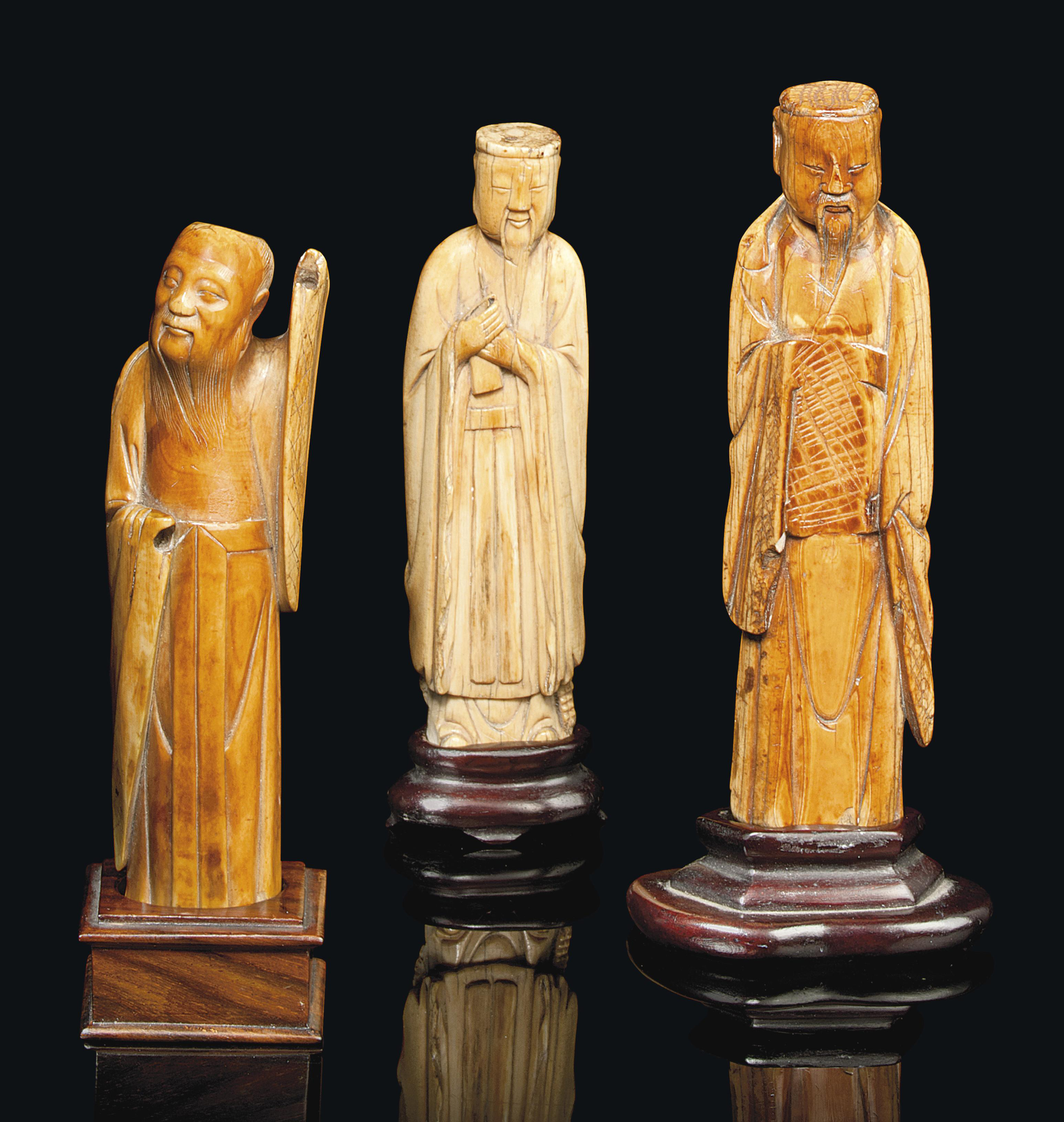 THREE CHINESE CARVED IVORY FIG