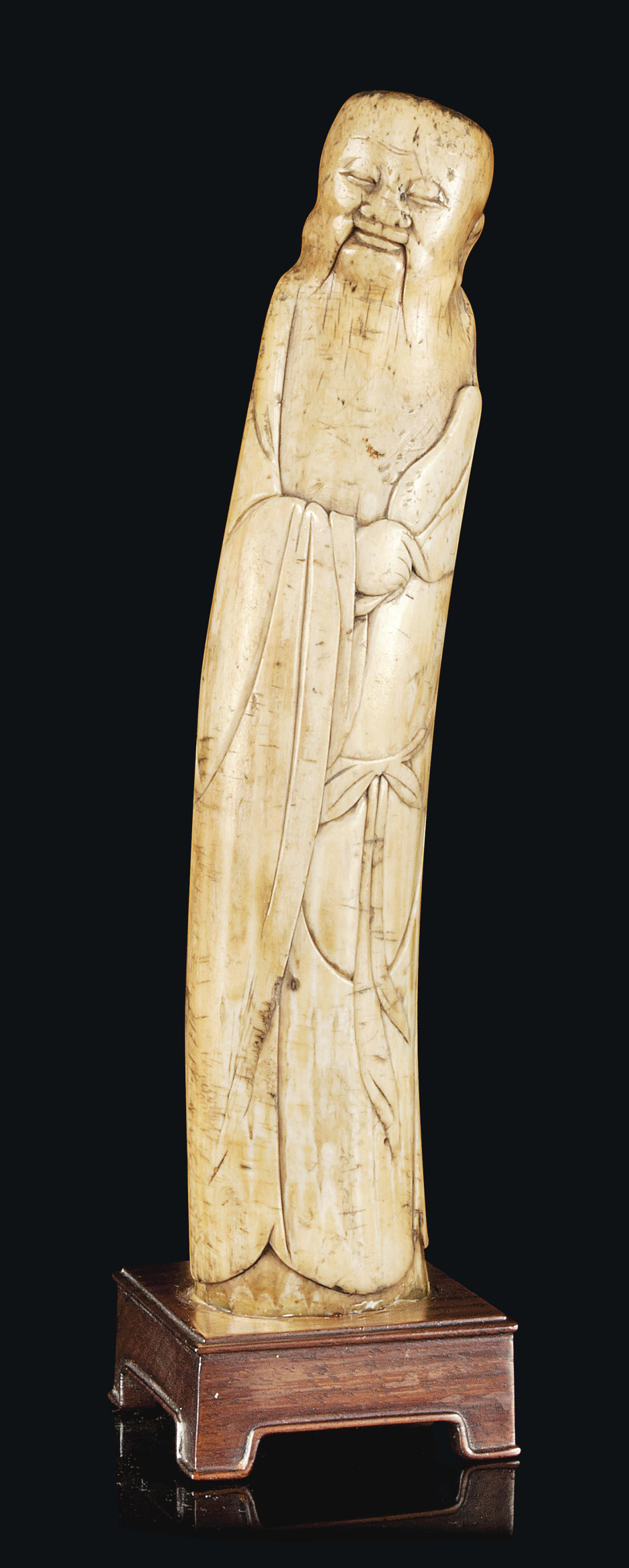 A CHINESE IVORY CARVING OF ZHO