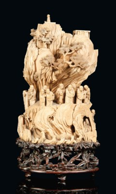 A CHINESE CARVED IVORY MOUNTAI