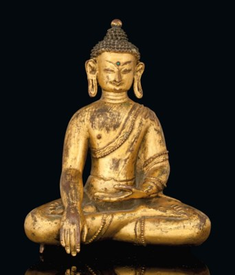A TIBETAN GILT COPPER FIGURE O