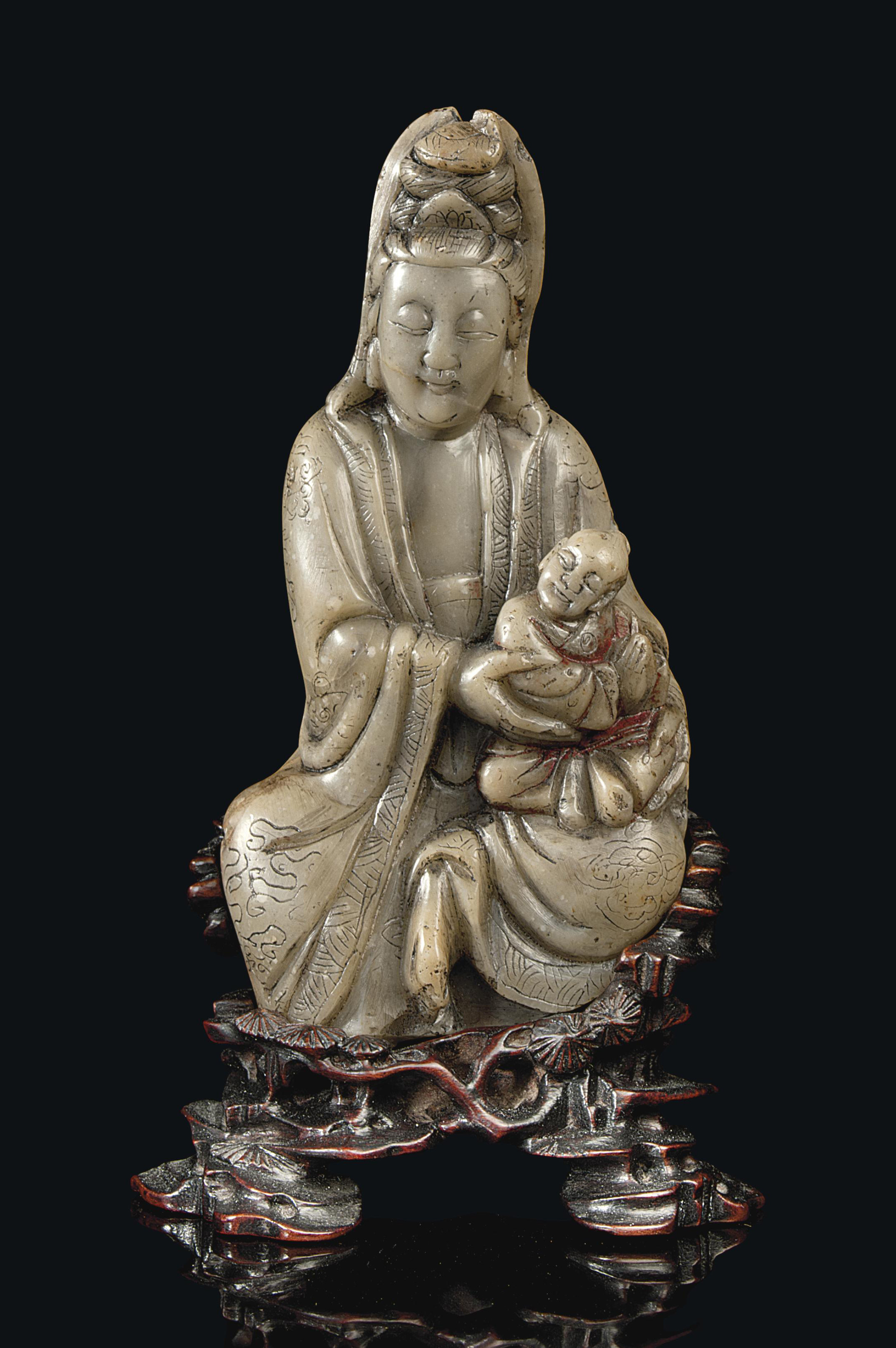 A CHINESE SOAPSTONE FIGURE OF