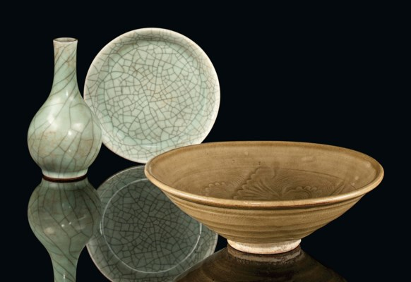 A CHINESE CELADON CARVED BOWL,