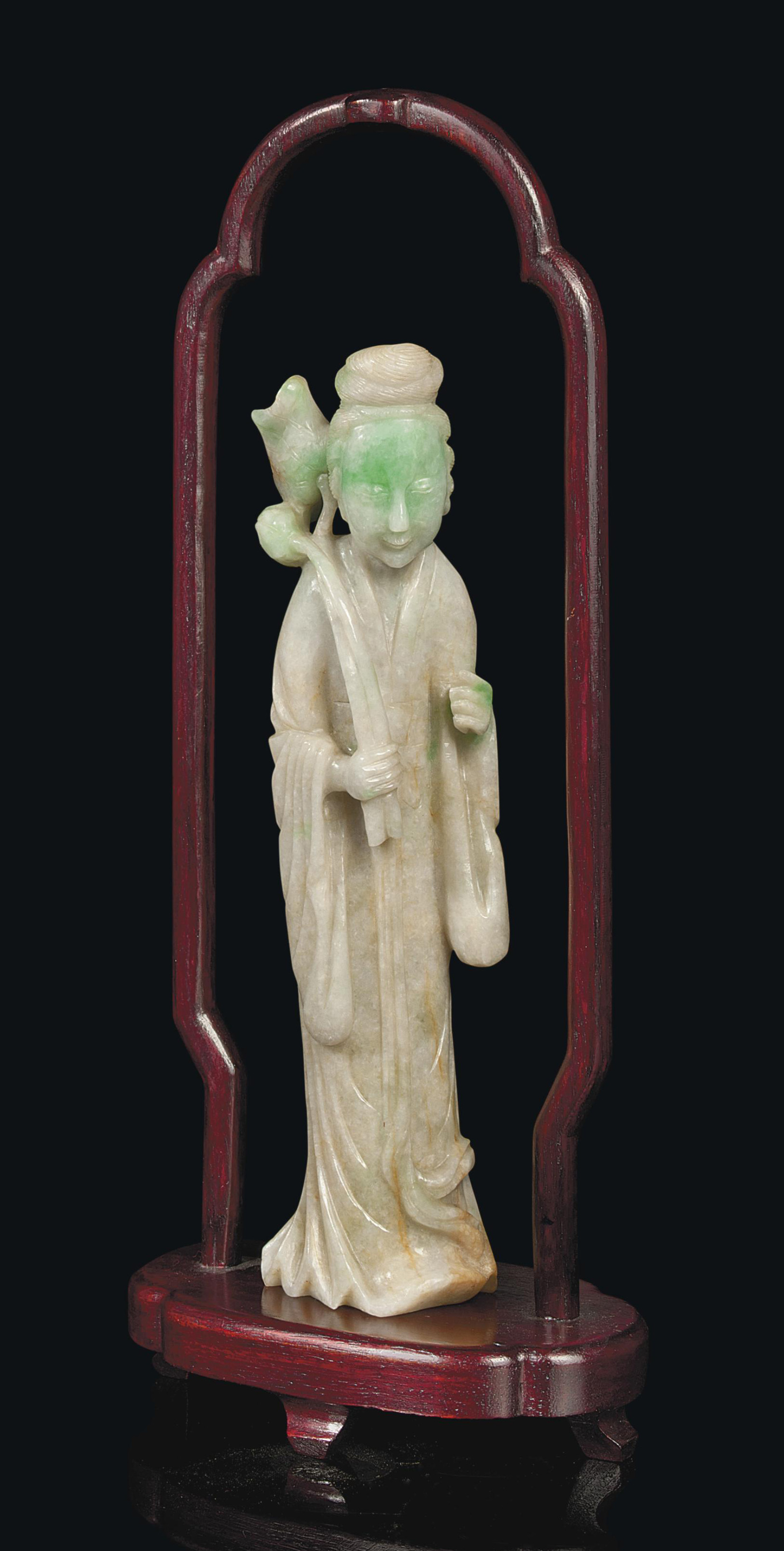 A CHINESE JADEITE FIGURE OF A