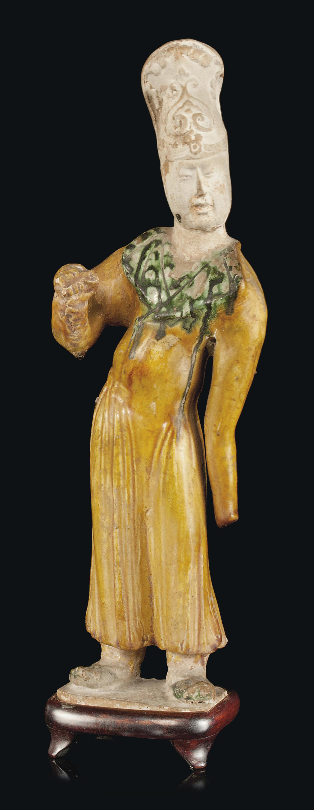 A CHINESE POTTERY FIGURE OF A