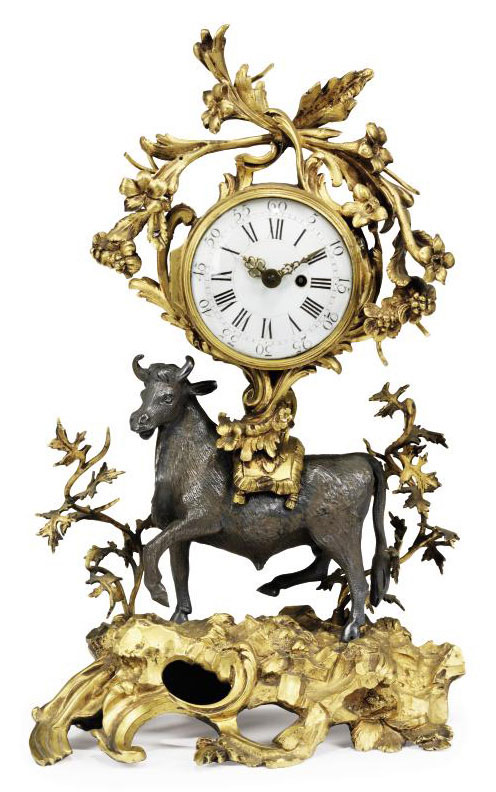 A FRENCH ORMOLU AND SILVERED BRONZE BULL MANTEL CLOCK,THE MOVEMENT BY CHARLES MASON, LONDON.