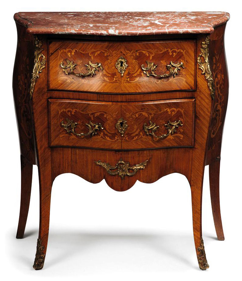 A FRENCH TULIPWOOD AND FLORAL MARQUETRY INLAID SERPENTINE COMMODE