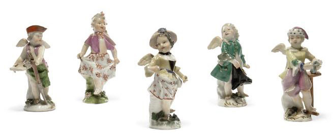 A GROUP OF FOUR FIGURES OF CUPID IN DISGUISE AND A DANCING GIRL