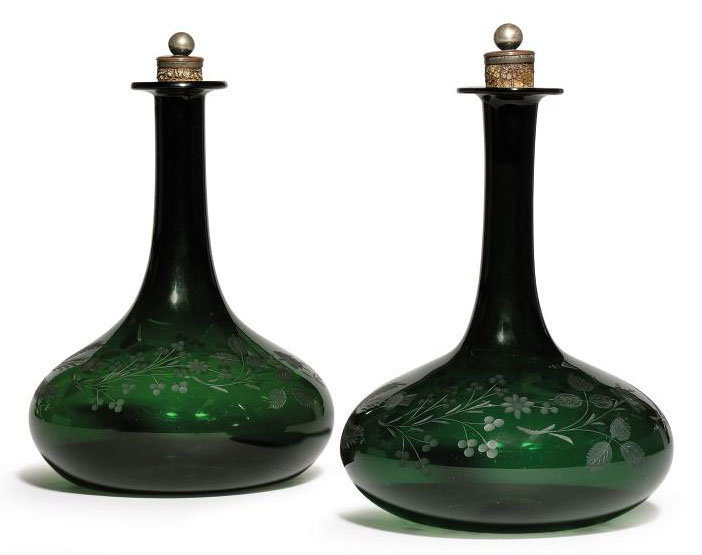 A PAIR OF ENGRAVED GREEN-GLASS DECANTERS AND STOPPERS
