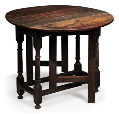 A GEORGE II OAK GATE-LEG TABLE