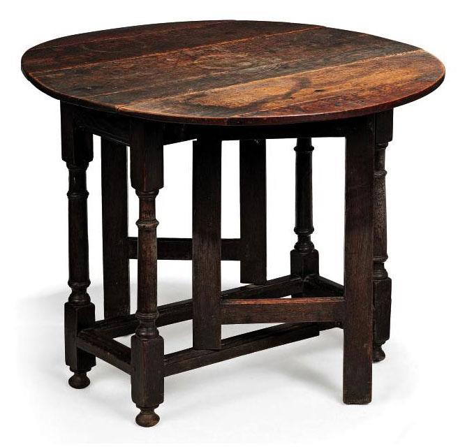 A GEORGE II OAK GATE-LEG TABLE