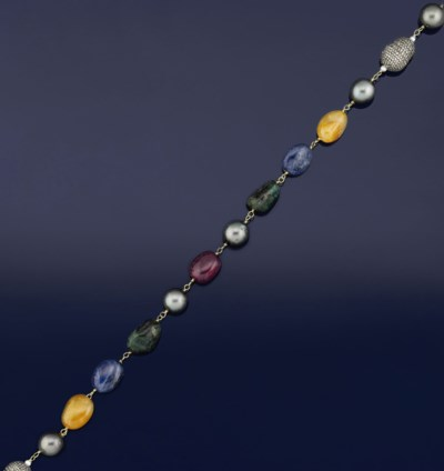 A cultured pearl, gem and diam