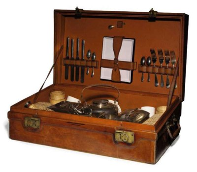 A GEORGE V LEATHER-CASED PICNI