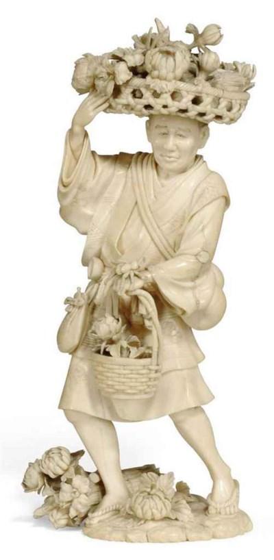 A JAPANESE IVORY OKIMONO