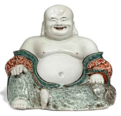 A CHINESE PORCELAIN FIGURE OF