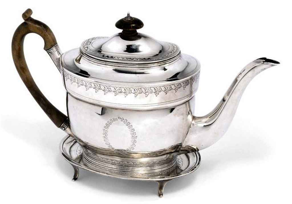 A GEORGE III OVAL SILVER TEAPOT WITH MATCHING STAND