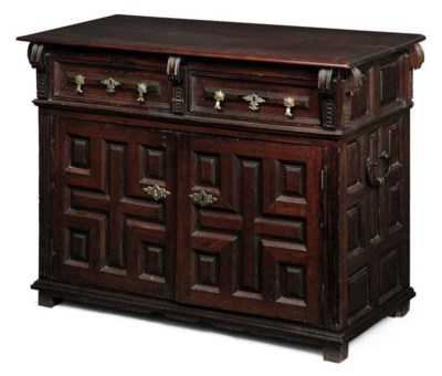 A CARVED AND PANELLED WALNUT S