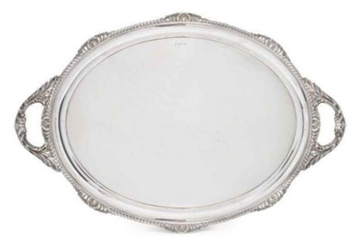 AN EDWARDIAN SILVER OVAL TWO H
