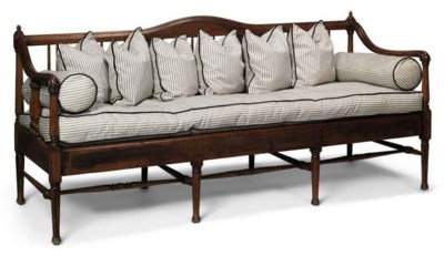 AN AMERICAN WALNUT SETTEE