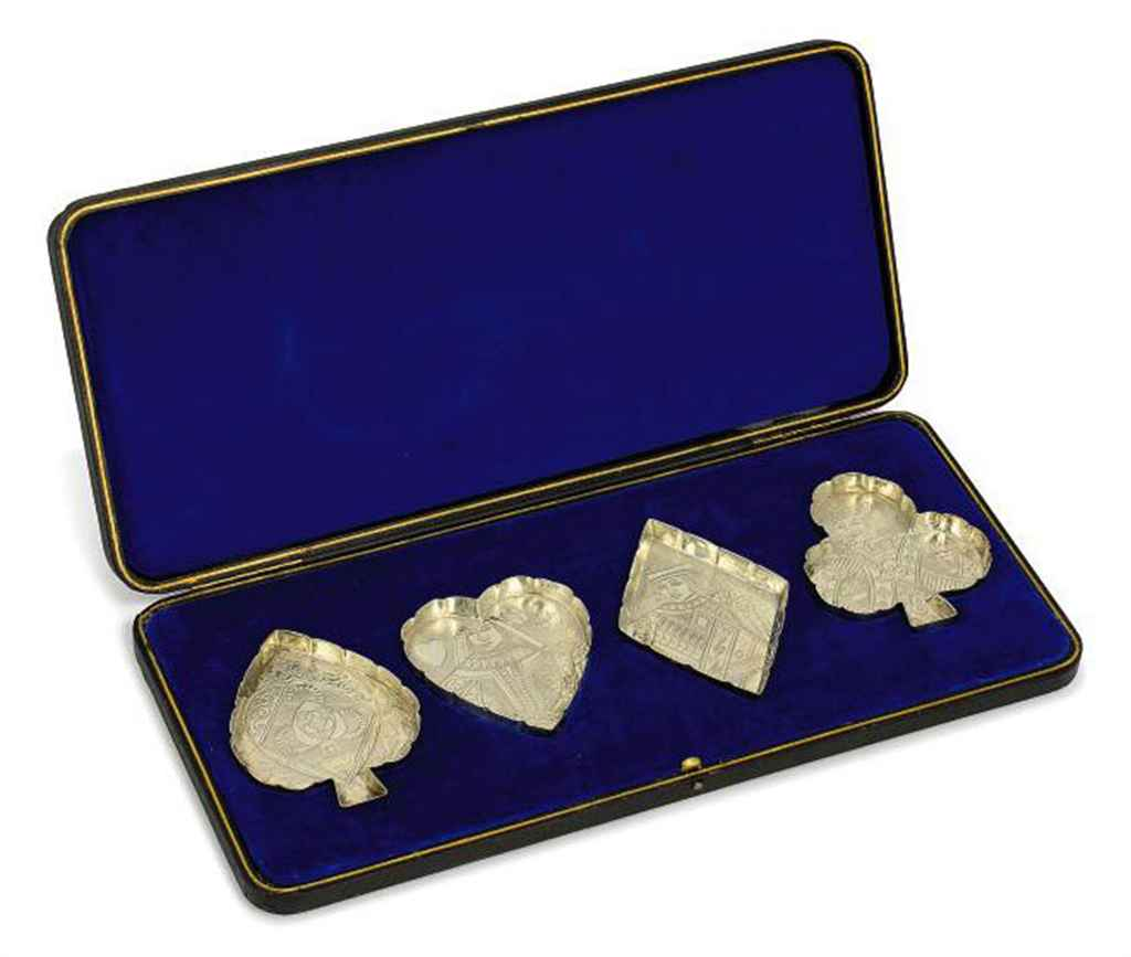 A SET OF FOUR VICTORIAN SILVER NOVELTY DISHES IN THE FORM OF THE FOUR SUITS OF CARDS
