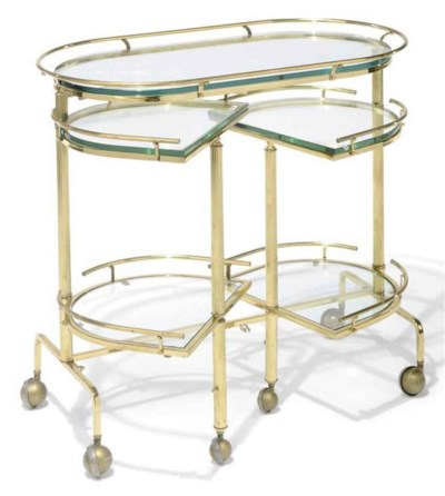 AN ENGLISH BRASS AND GLASS TRO