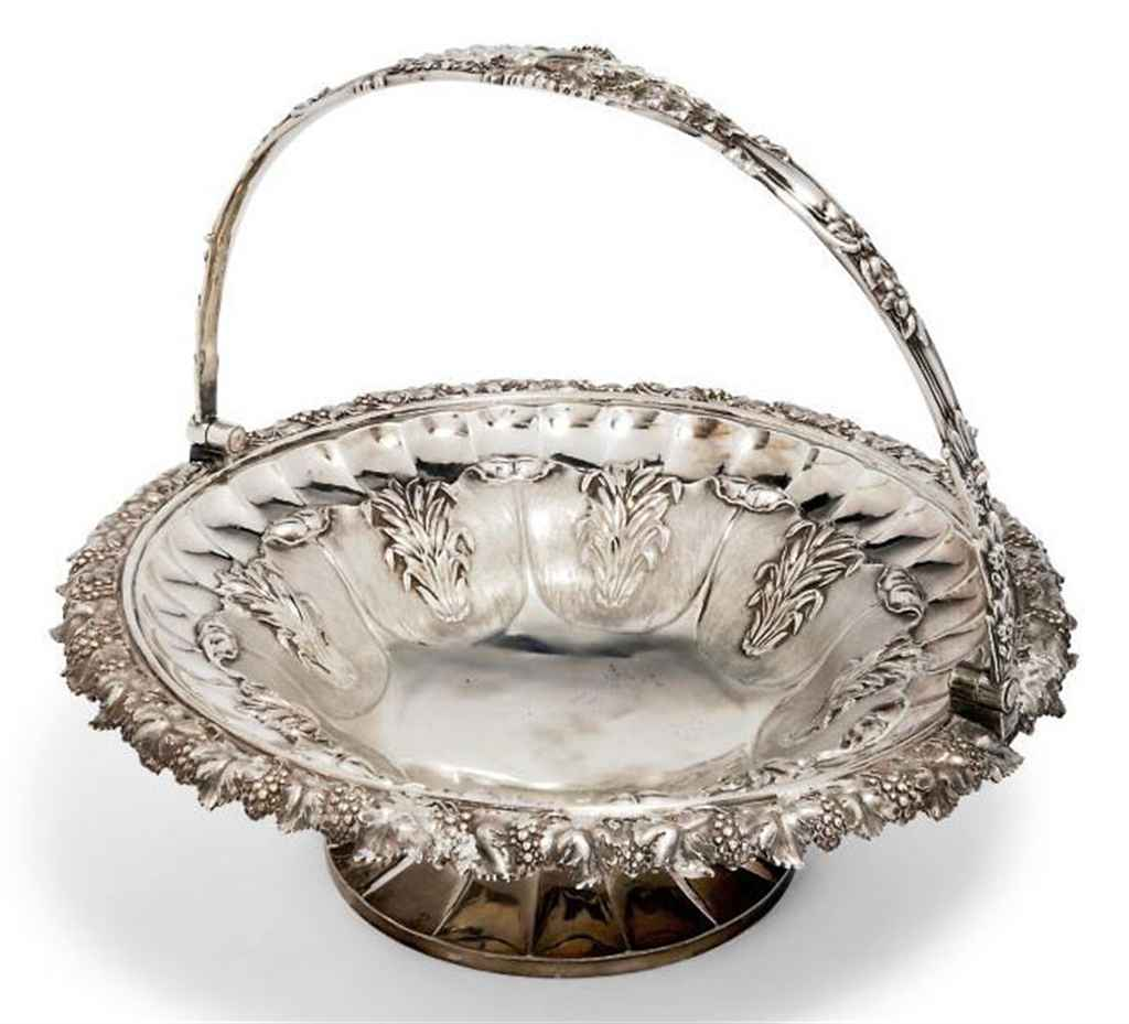 A GEORGE IV SILVER SWING-HANDLED CAKE BASKET