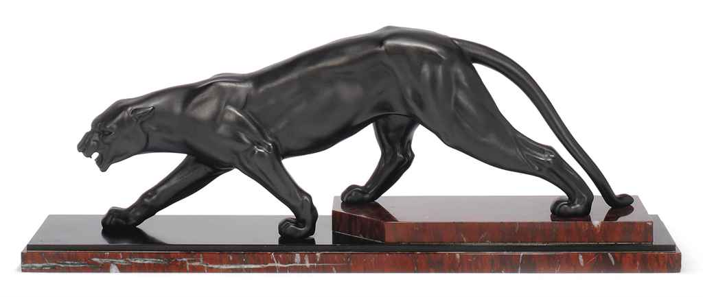 A LUC PATINATED SPELTER MODEL OF A PANTHER