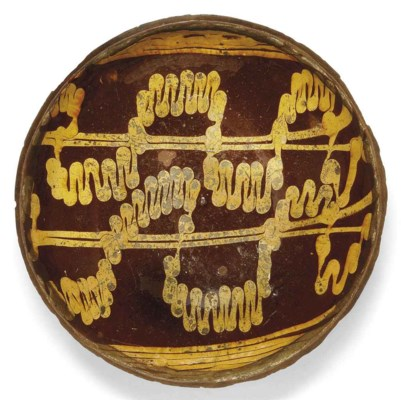 AN ENGLISH SLIPWARE CIRCULAR D