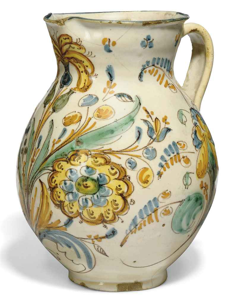A CONTINENTAL FAIENCE JUG