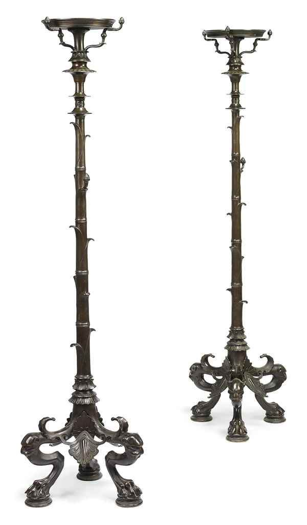 A PAIR OF BRONZE TORCHERES