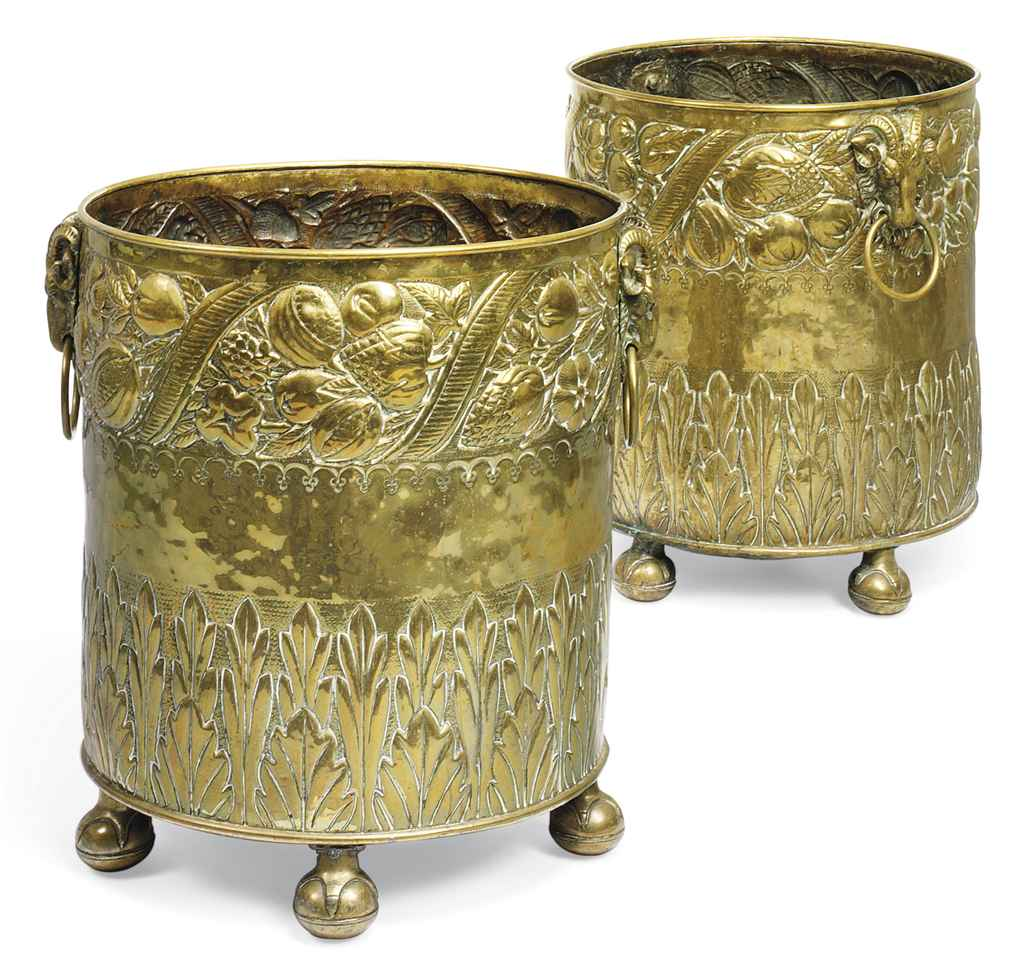 A PAIR OF DUTCH REPOUSEE BRASS