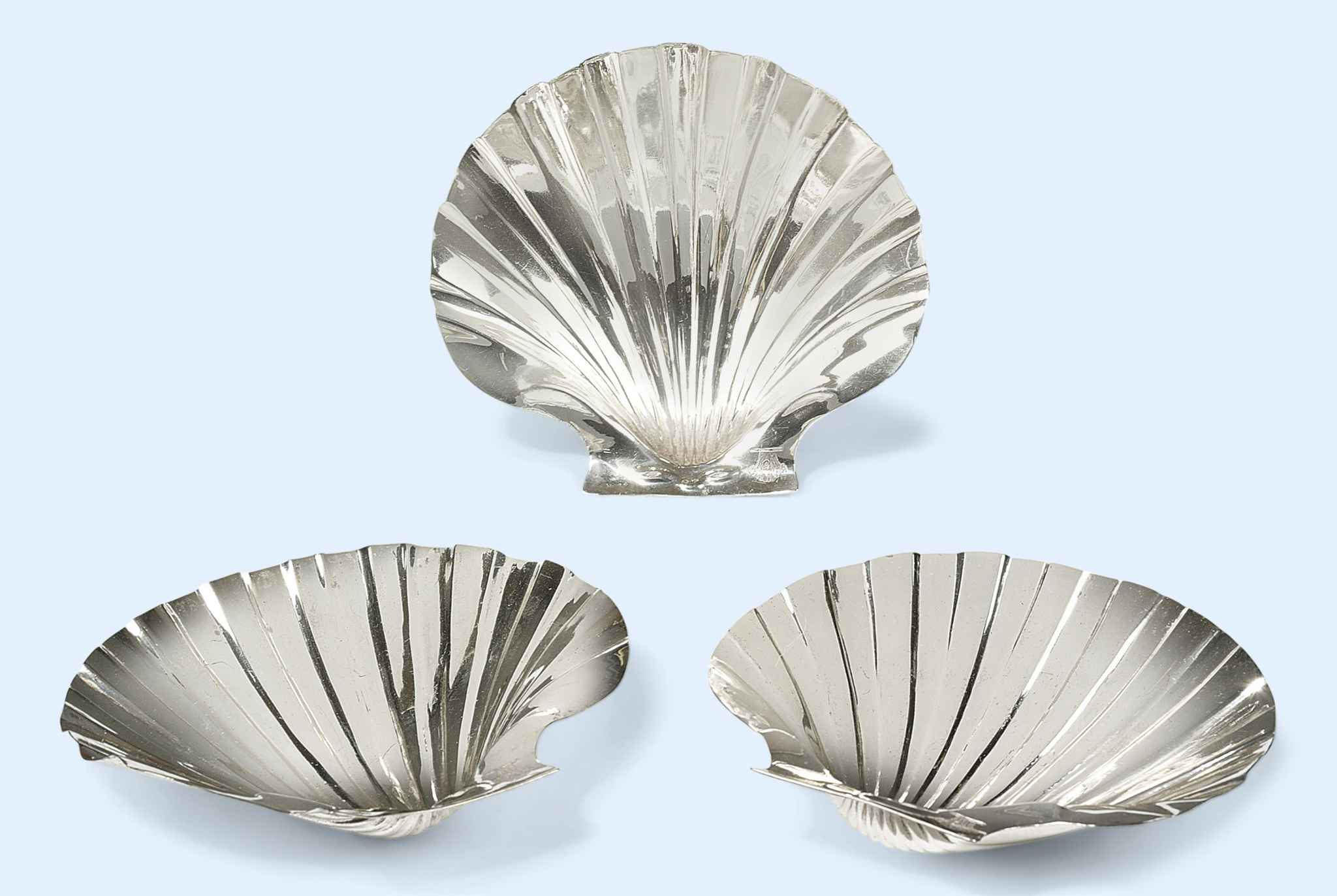 A SET OF THREE IRISH GEORGE III SILVER BUTTER SHELLS