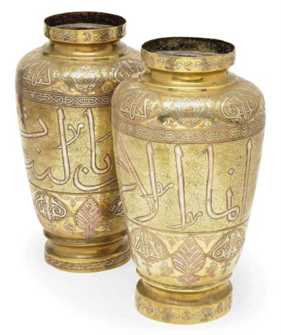 A PAIR OF CAIROWARE SILVER AND