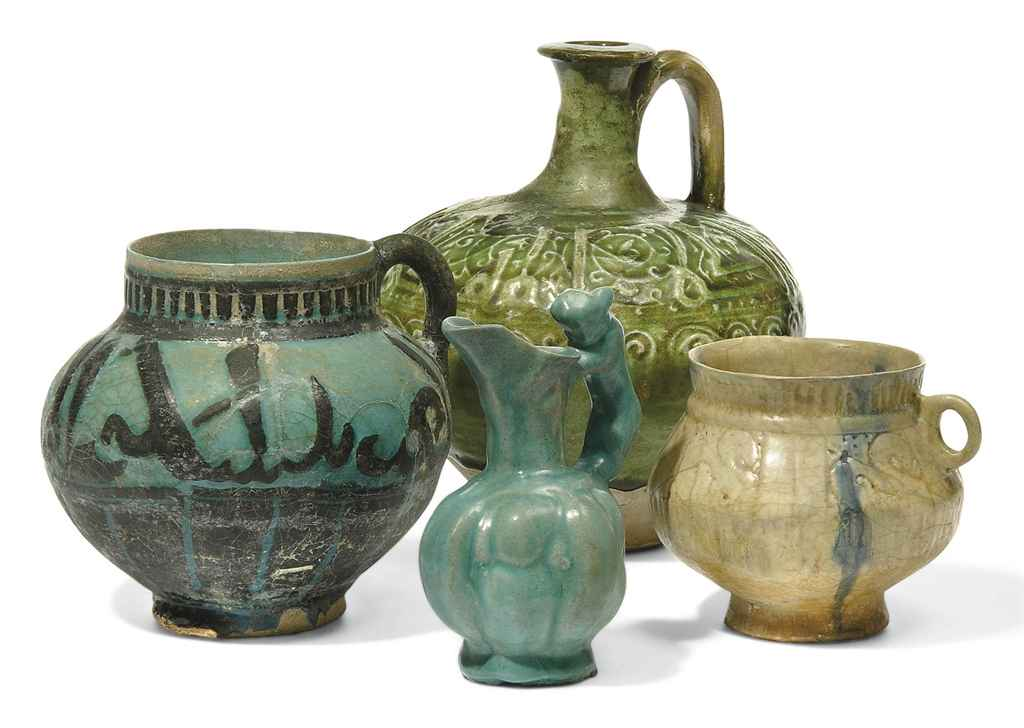 FOUR KASHAN POTTERY JUGS