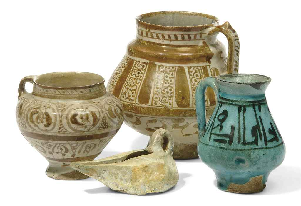 THREE KASHAN POTTERY JUGS