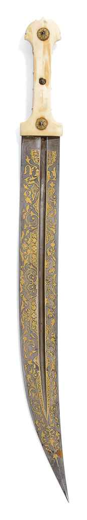 A WALRUS IVORY-HILTED GOLD-DAM