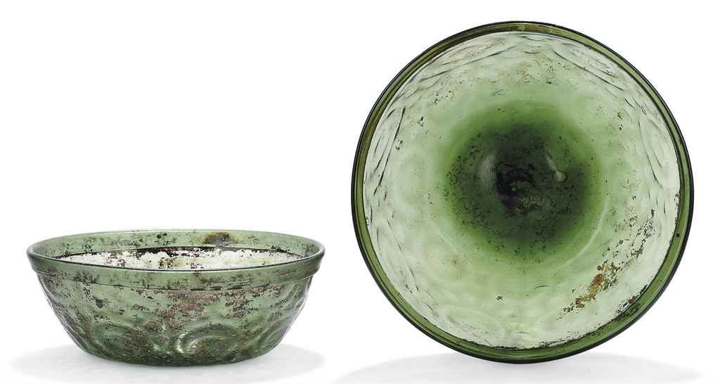 TWO INTACT MOULDED GREEN GLASS