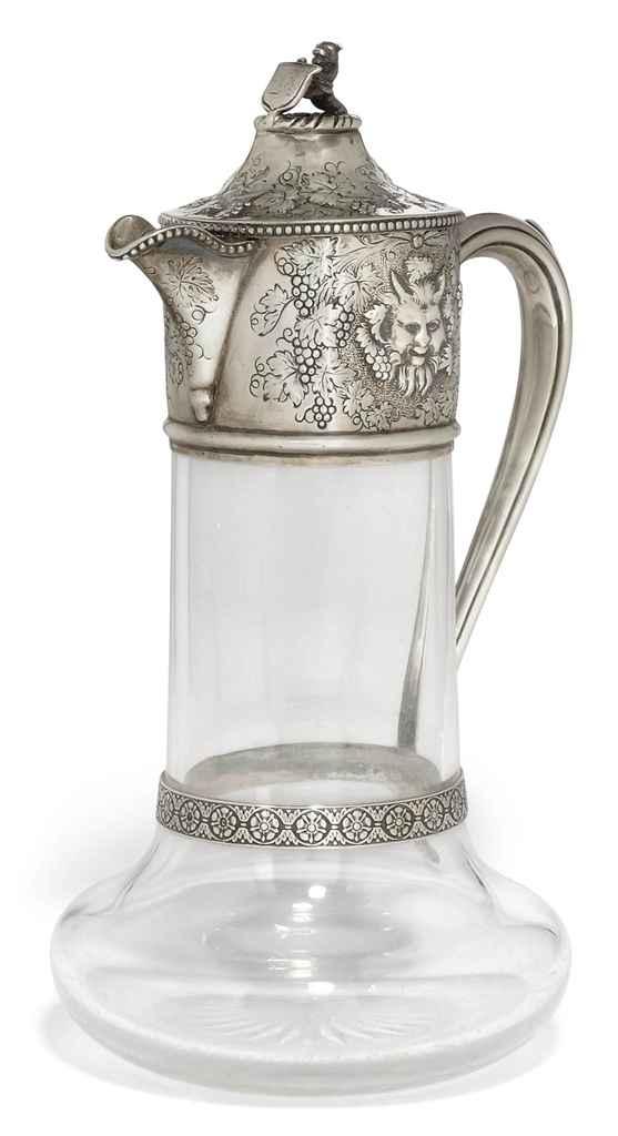 A VICTORIAN SILVER-MOUNTED PLAIN GLASS CLARET JUG
