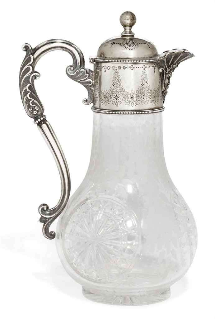 A VICTORIAN SILVER-MOUNTED CUT-GLASS CLARET JUG