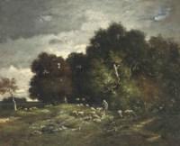 A shepherd grazing his flock