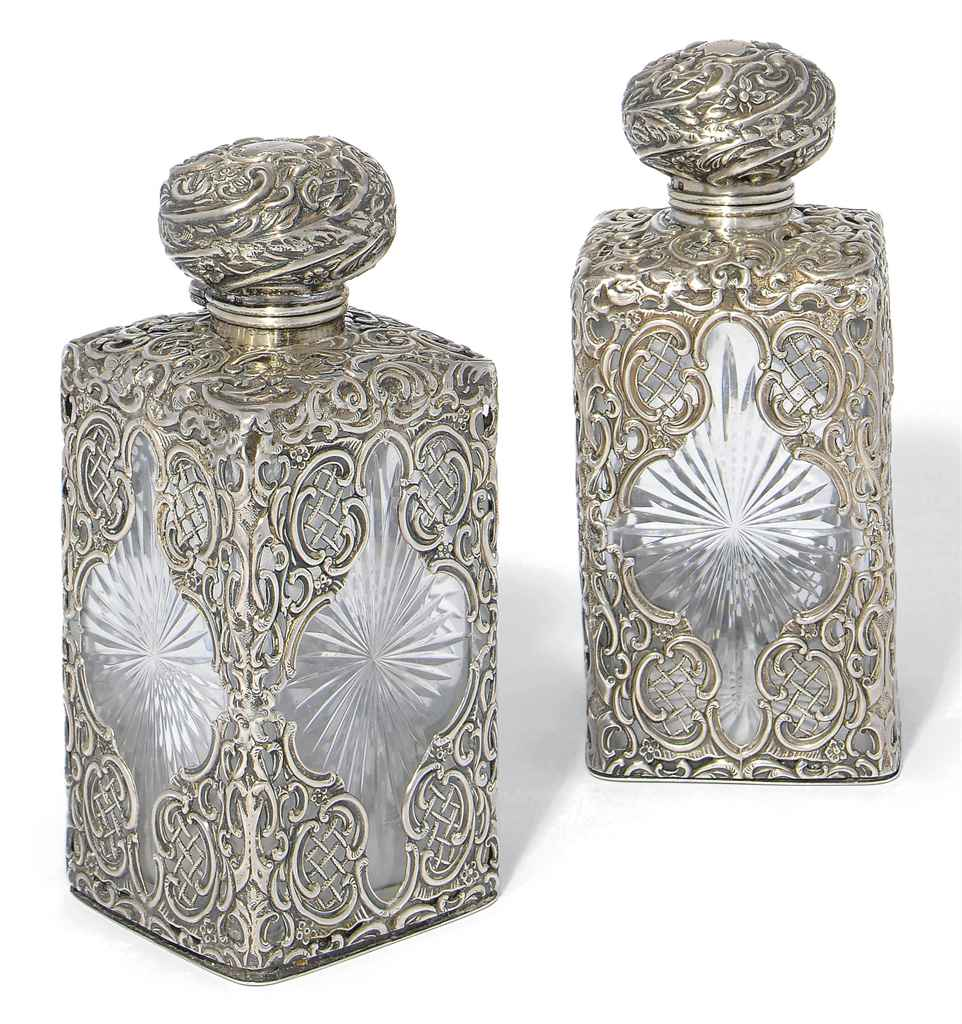 A PAIR OF VICTORIAN SILVER-MOUNTED CUT-GLASS COLOGNE BOTTLES