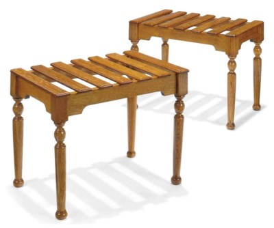 A PAIR OF OAK LUGGAGE STANDS