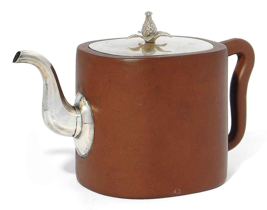 A RED STONEWARE TEAPOT WITH GE