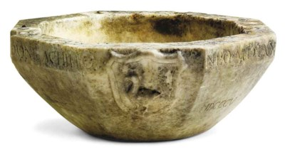 A CARVED STONE FONT BOWL