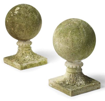 A PAIR OF COMPOSITION STONE SP