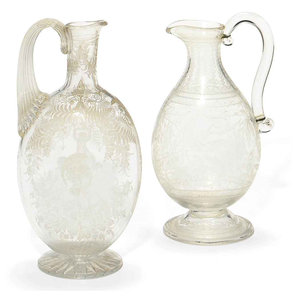 TWO STOURBRIDGE GLASS EWERS